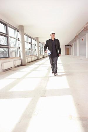 Architect checking construction site Reklamní fotografie