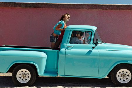 5 young people traveling in pickup truck