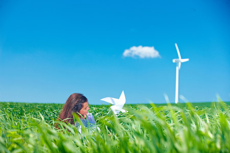 Girl with wind turbine Foto de archivo