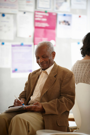 Elderly black man in waiting room Stock Photo
