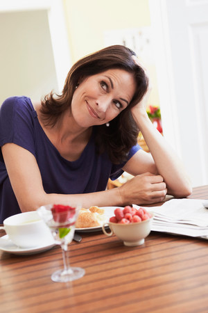 Woman having breakfast 写真素材