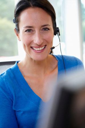 Receptionist behind her desk, smiling