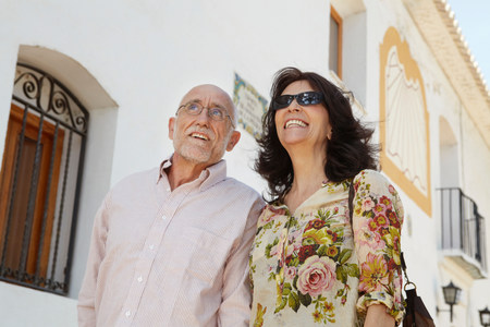 Older couple strolling past old church