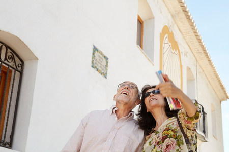Older couple looking at attractions