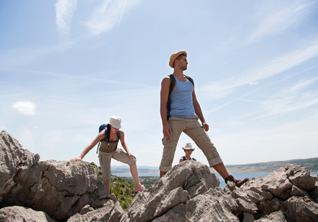 Hikers on coastal path Stock Photo