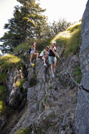 Girls rockclimbing through the foothills