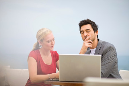 Couple working at laptop