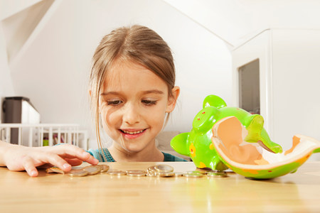 Little girl counting money Stock Photo