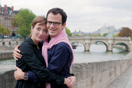 Couple embrace on banks of the Seine