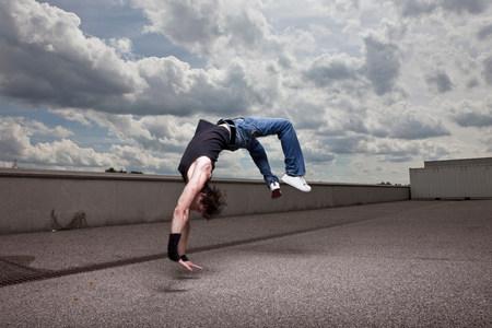 Young man jumping backwards