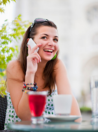 Young woman on phone in cafÈ