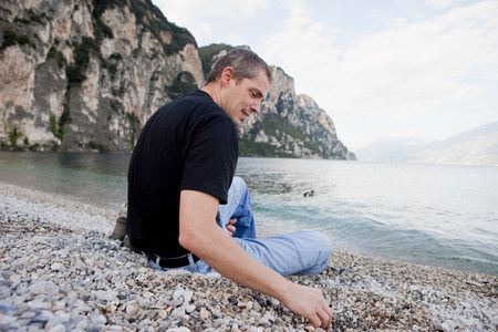 Man relaxing by the water