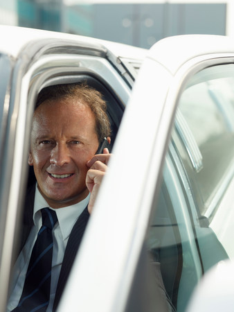 Driver on the phone in limousine