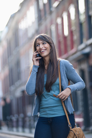 Young female on phone in street Banque d'images