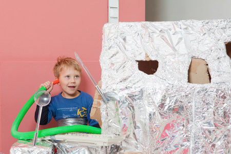 Boy with space house, communicating Stock Photo