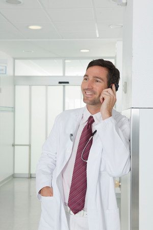 Doctor on the phone in hall