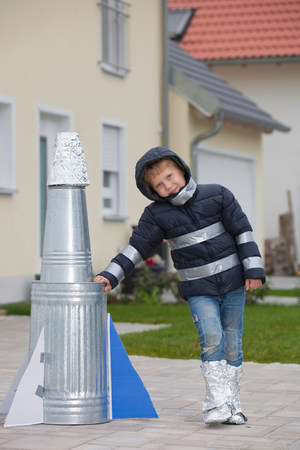 Boy with self-made rocket, happy