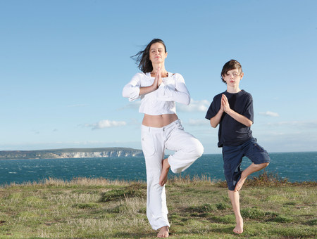 Mother and son practicing yoga Imagens