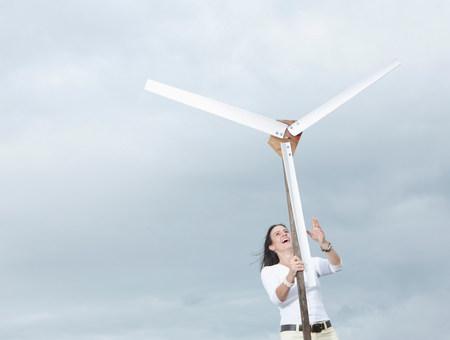 Woman with wind turbine