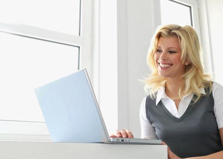 Happy business women at work 版權商用圖片