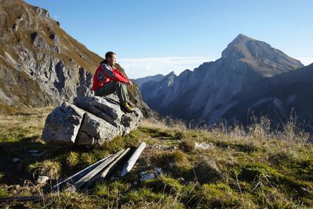 Man relaxing after hill walk Imagens