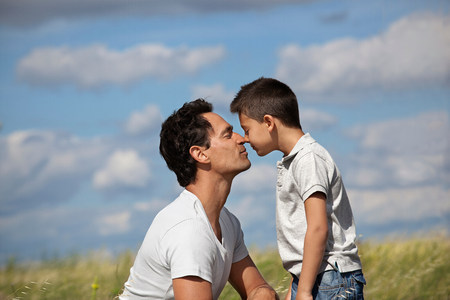 Father and son in a field