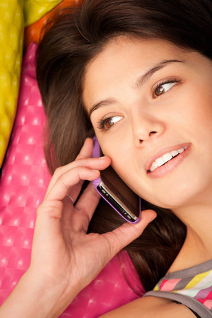 Headshot of a woman phoning and lying