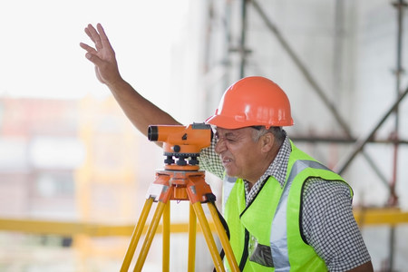 Worker with measuring equipment