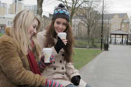 2 young women with take up cups