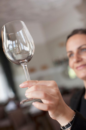 Woman cleaning wine glass