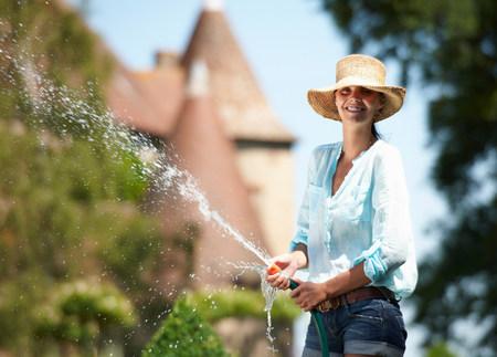 Woman watering the garden Stock Photo