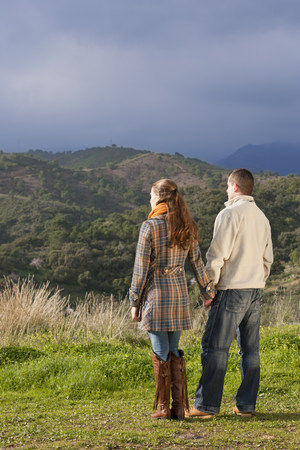 Young couple holding hands in nature