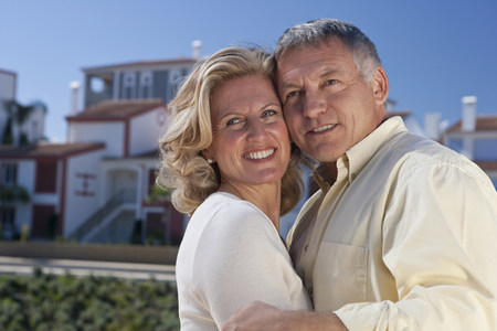 Mature couple by property development
