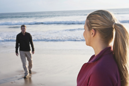Young couple meeting each other at beach