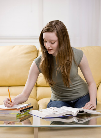 Girl studying in living room