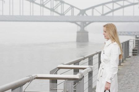 Woman overlooking city river Imagens