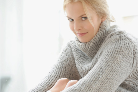 Woman wearing thick sweater