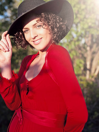 Woman in red dress wearing sunhat
