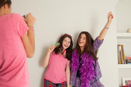 teenage girls singing , wearing pyjamas