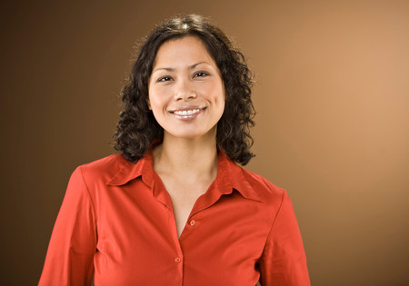 Smiling woman wearing red blouse