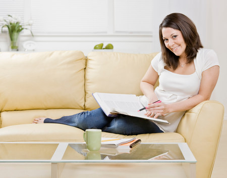Woman studying on couch