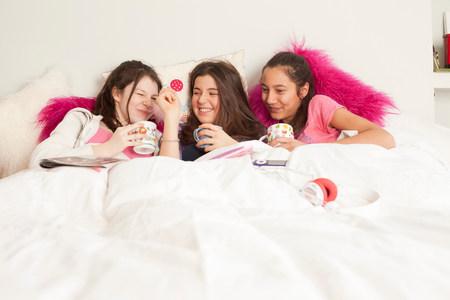 teenage girls laughing and playing music