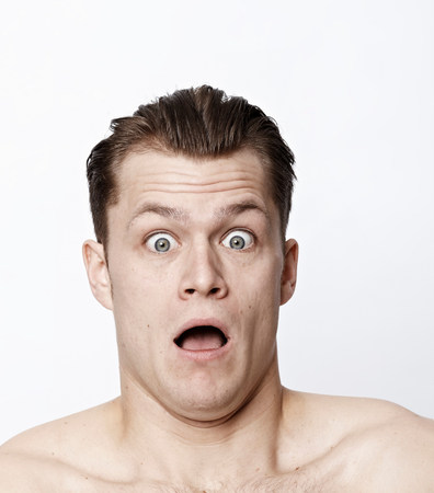 Nude man making a funny face Stock Photo