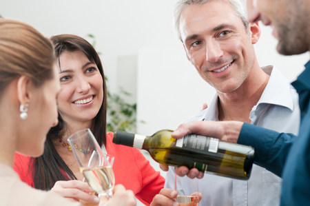 Friends celebrating together with wine