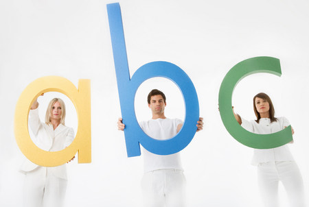 People holding letters a, b, c Stok Fotoğraf