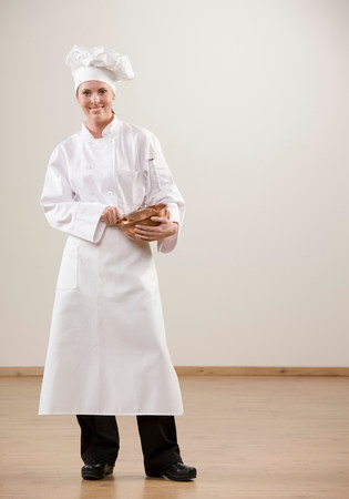 Smiling chef holding mixing bowl