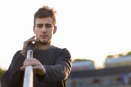 Man carrying pole outdoors Reklamní fotografie