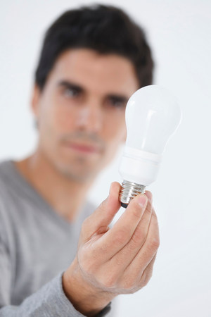 Man holding light bulb Reklamní fotografie