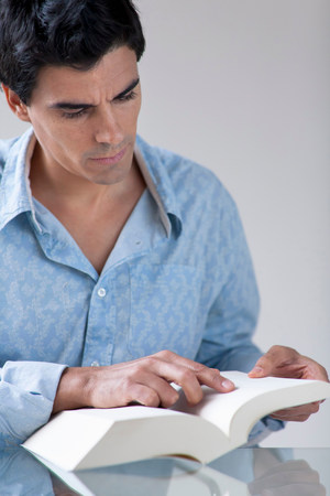 man Reading a book Banco de Imagens