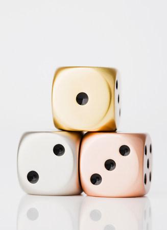 Metallic dices on winners podium